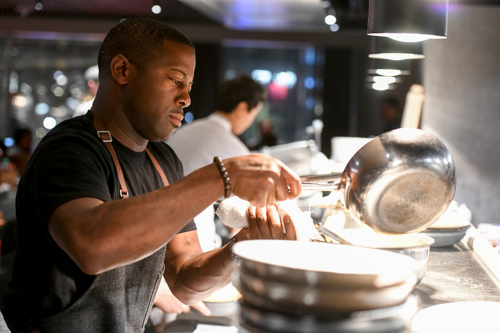 Chef Edouardo Jordan at work in a HAL cruise ship kitchen.