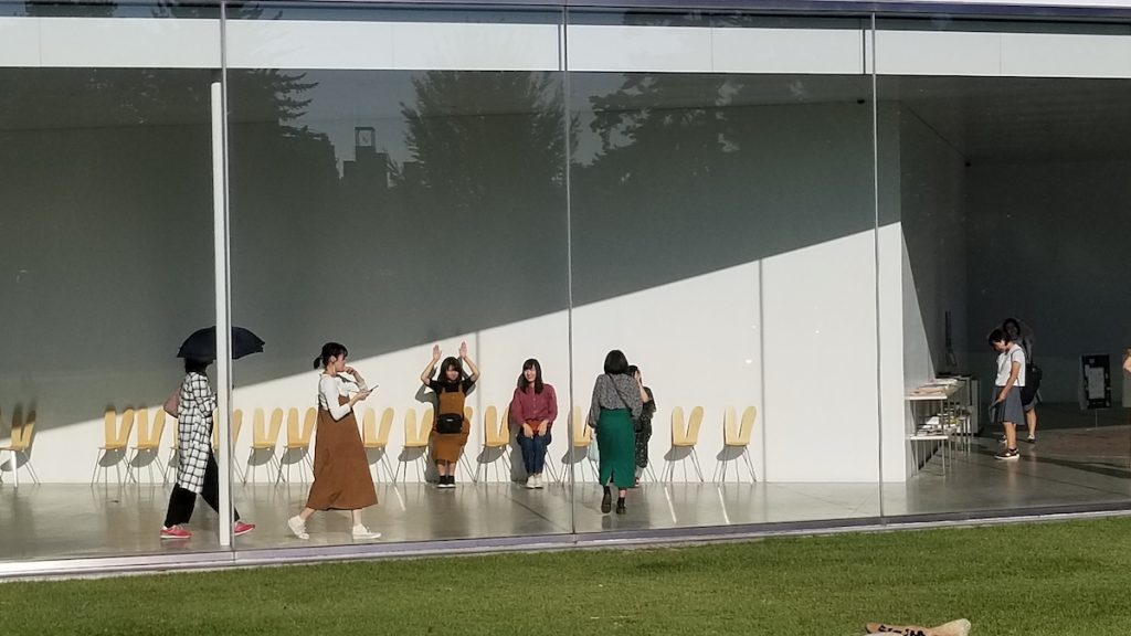 Visitors play with chair sculptures at 21st Century Art Museum in Kanazawa.