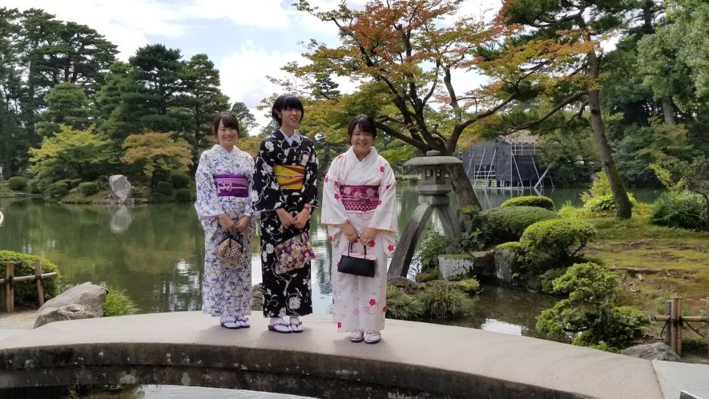Kanazawa students in traditional kimonos at Kenroku-en Gardens.