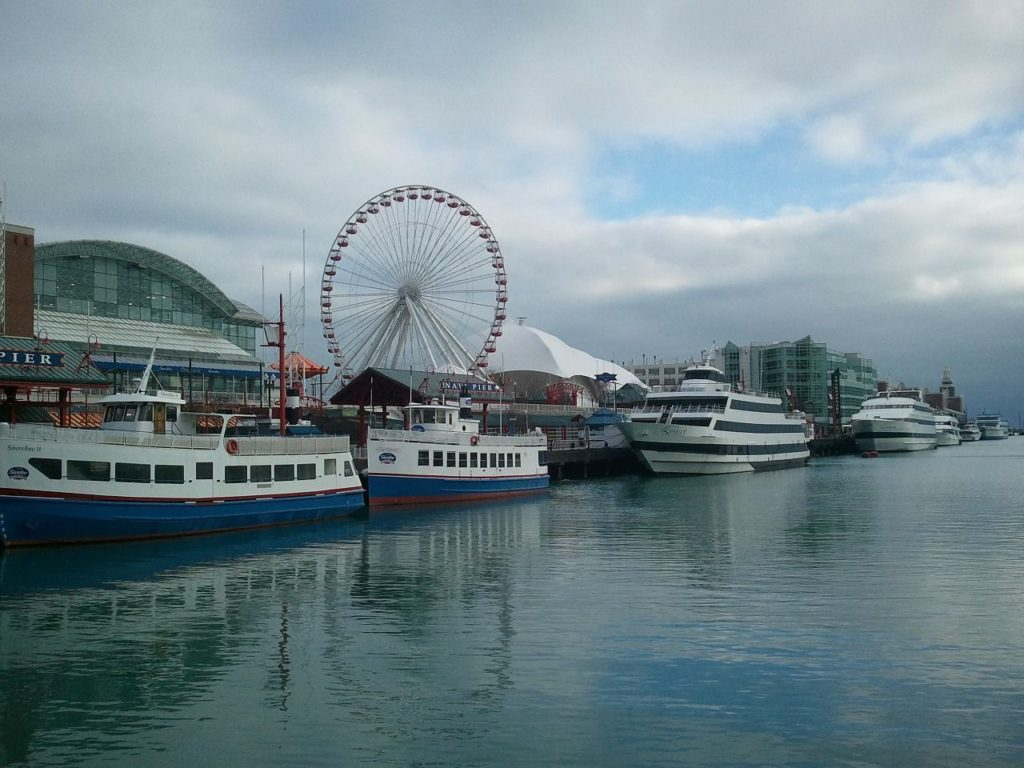 Sightseeing boats and attractions line Chicago's Navy Pier.