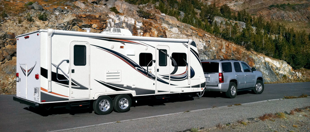 Conventional travel trailer towed by an SUV