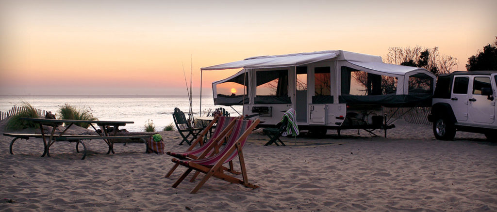 Pop Up Camper Trailer parked by the beach.