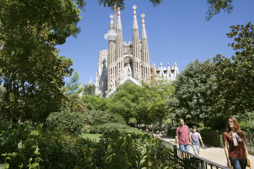 Family walking near Sagrada Familia in Barcelona.