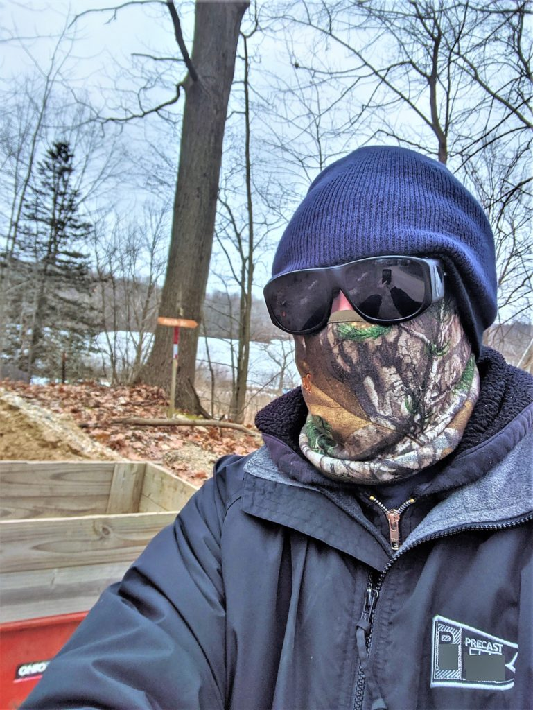 face covering on man in woods