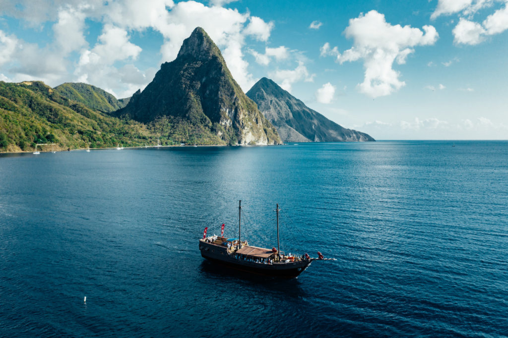 Sightseeing boat off the coast of St. Lucia with Pitons in the distance.