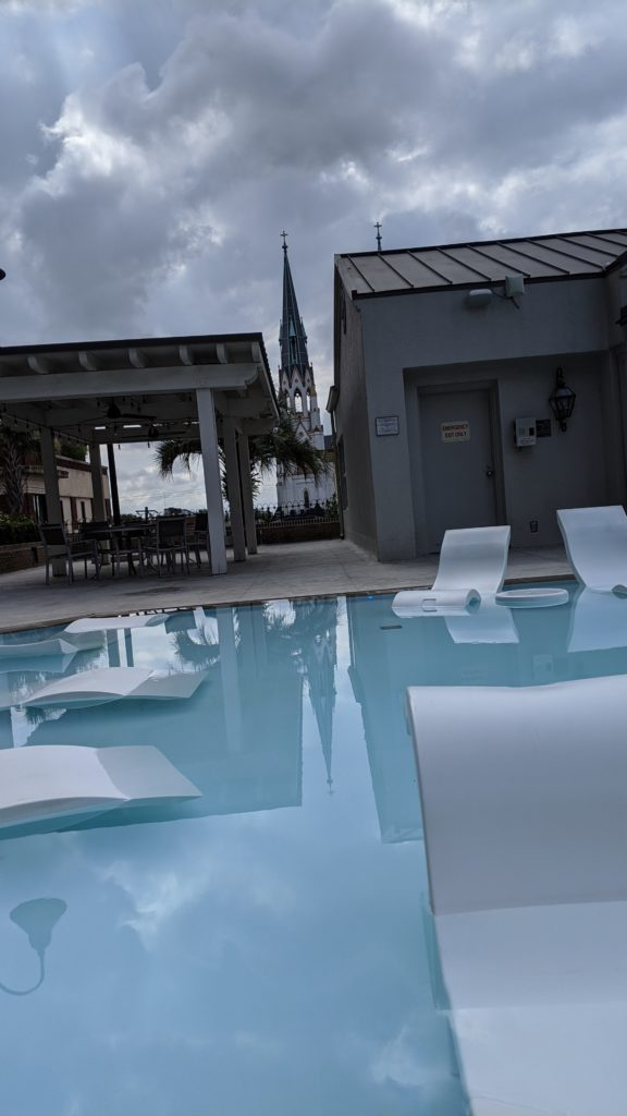 Stylish hotel pool deck at dusk.