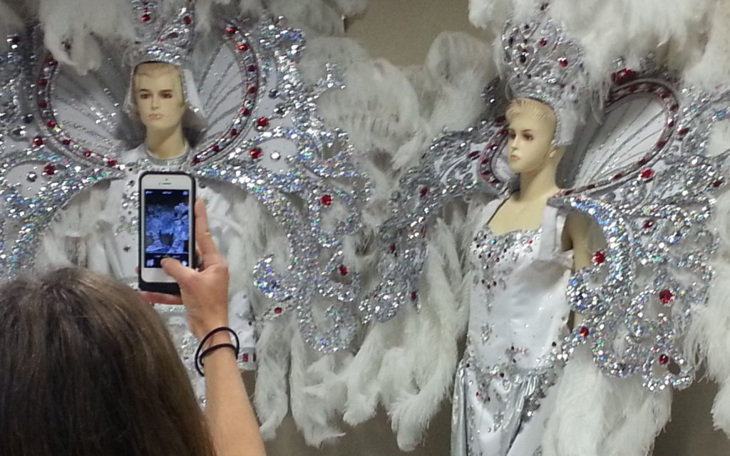 Mardi Gras costumes on display at the local museum highlight the flamboyance of Mardi Gras festivals.