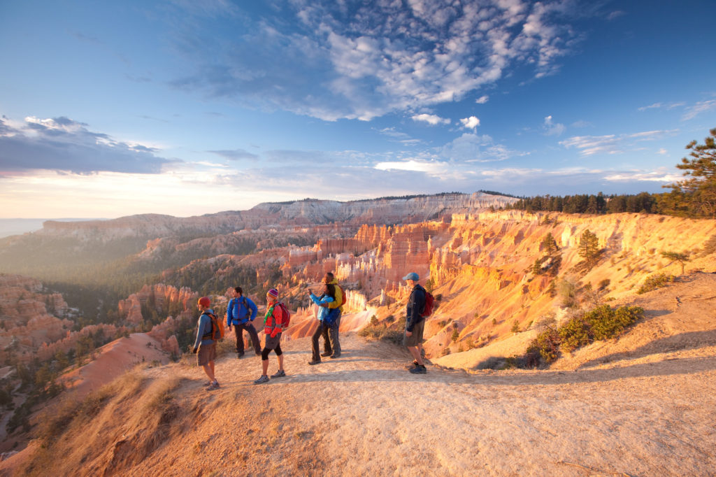 Small group of hikers at Bryce Canyon overlook.