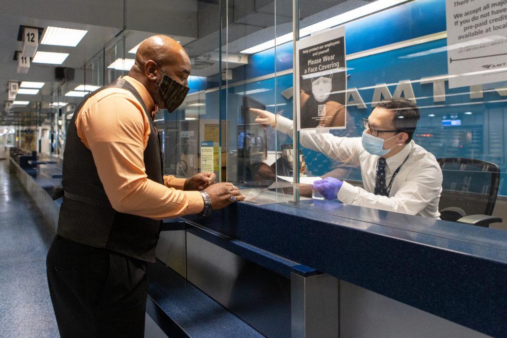 Amtrak ticket buyer in facemask.