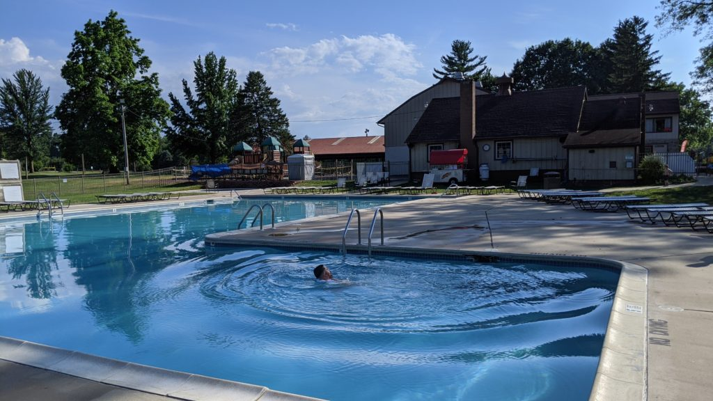 Circle M Campground swimming pool and main activities building.