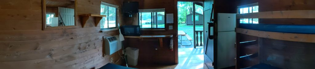 Panoramic view inside our Jellystone Park Rustic Cabin.