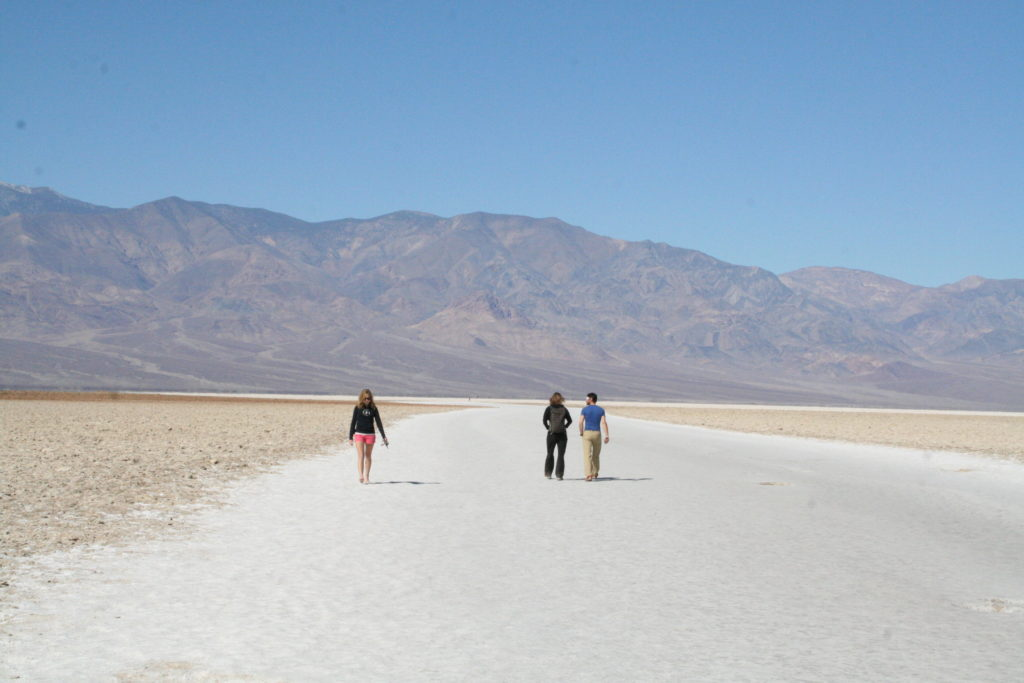 Hikers walking the Badwater Trail in Death Valley National Park.