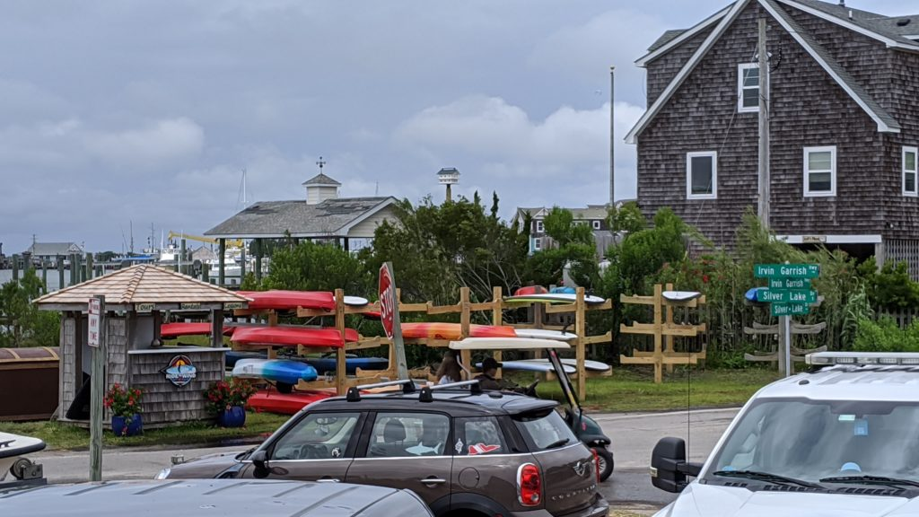Cars and surfboards at the Ocracoke Harbor.