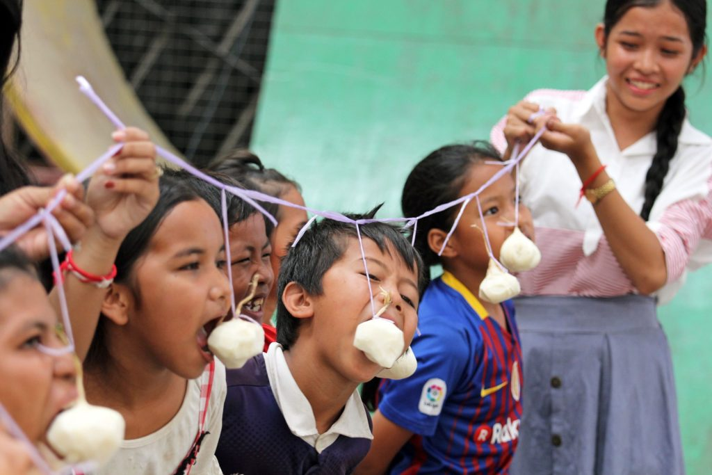 Kids eating contest during the Khmer New Year