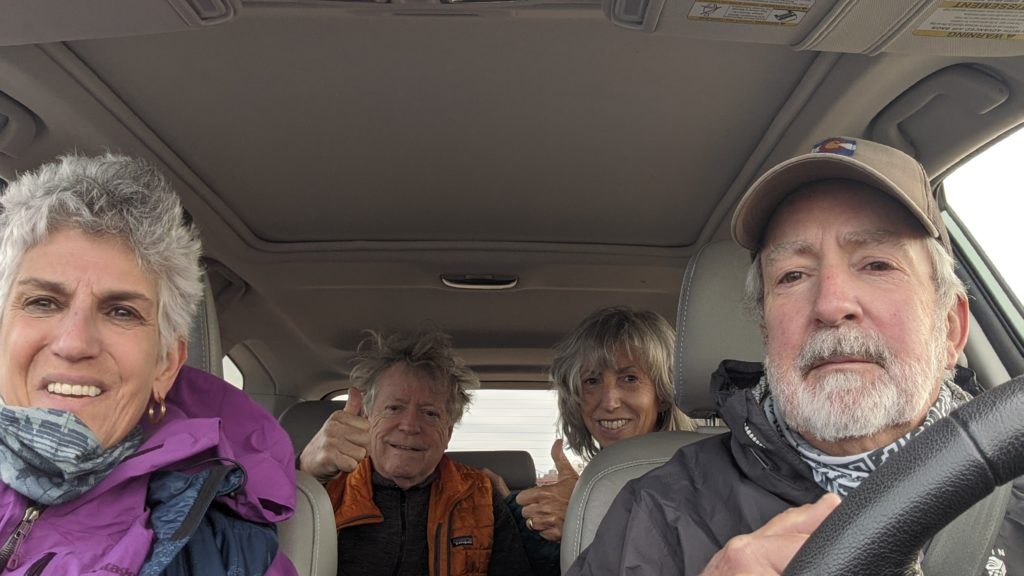 Four seniors driving in SUV in Colorado.