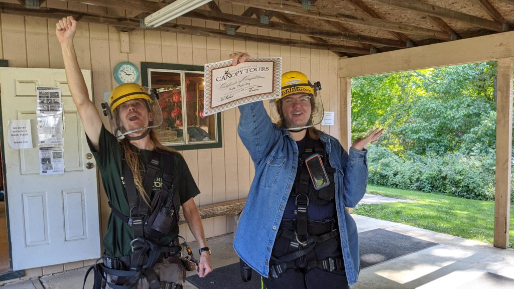 Hocking Hills Canopy Tour guides Kyle and Emma give us graduation certificates.