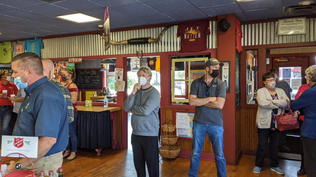 Masked up crowds out the door at Ruby's Smokehouse in Illinois