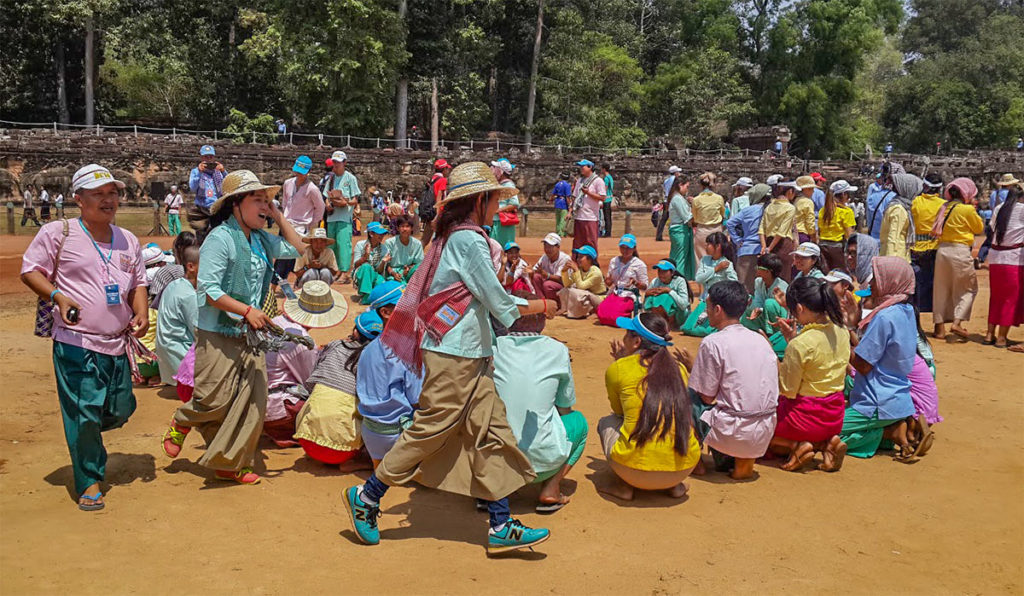 Local Khmer villagers perform in traditional costumes for Khmer New Year.