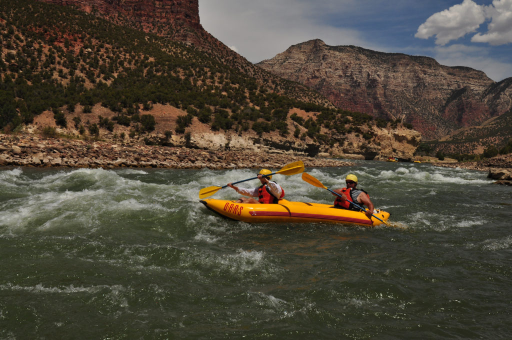 Two people in a kayak on the Green River.