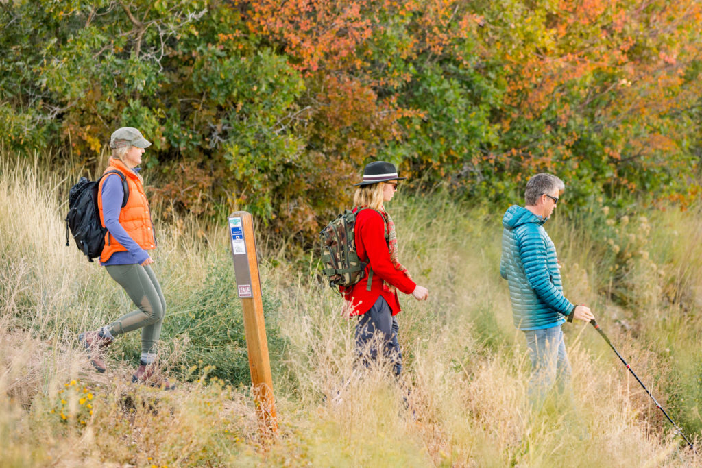 Three hikers enjoy fall getaway in Park City Utah