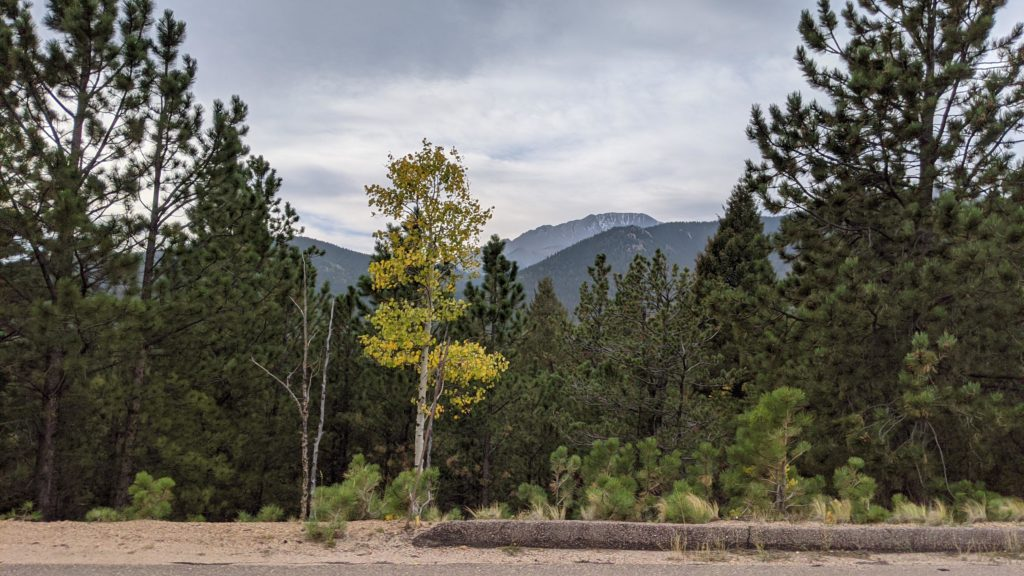Snow capped Pikes Peak, 14,000+ feet, in the distance.