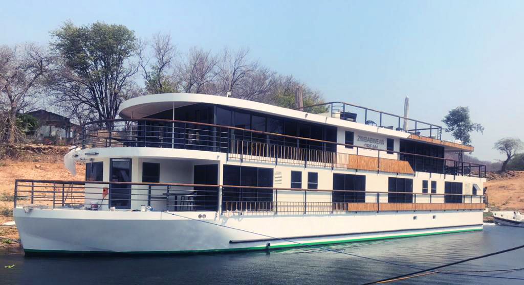 The Zimbabwean Dream river cruiser in port along the Zambezi River, Africa.