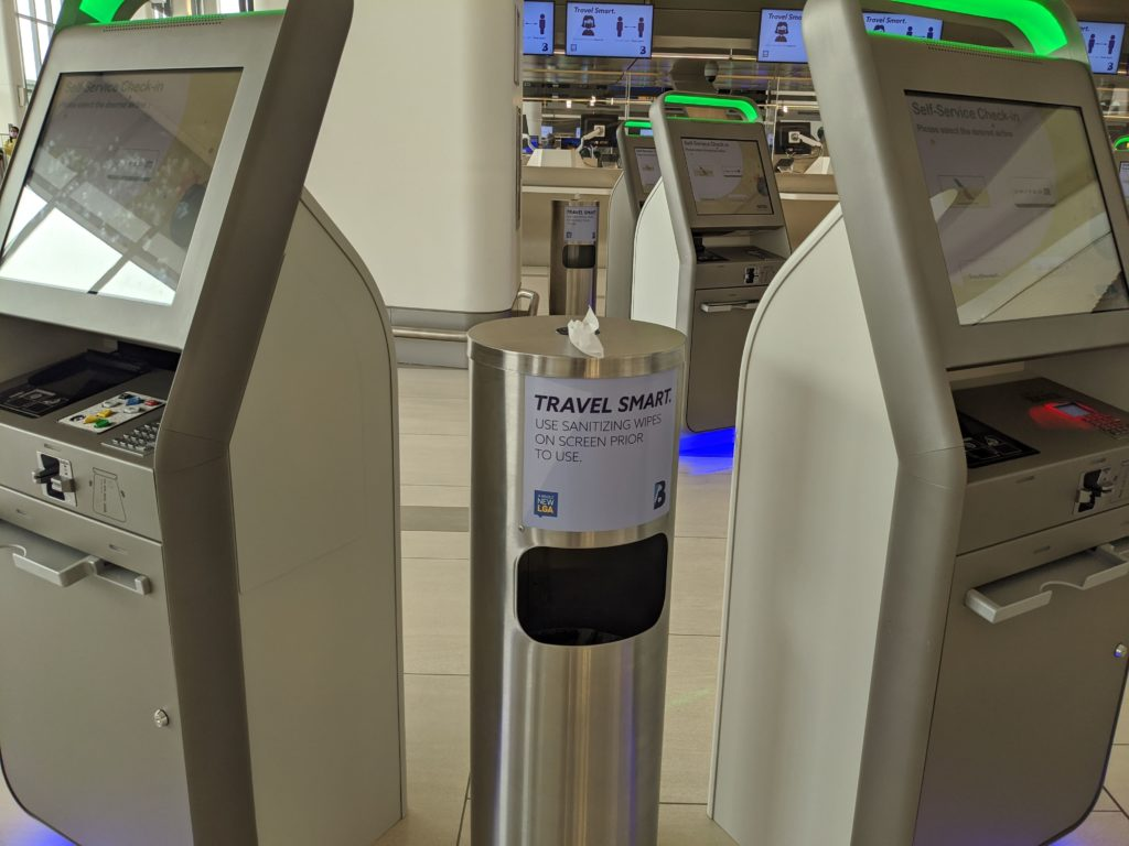 Hand wipes stations are next to every check-in kiosk at LaGuardia Terminal B