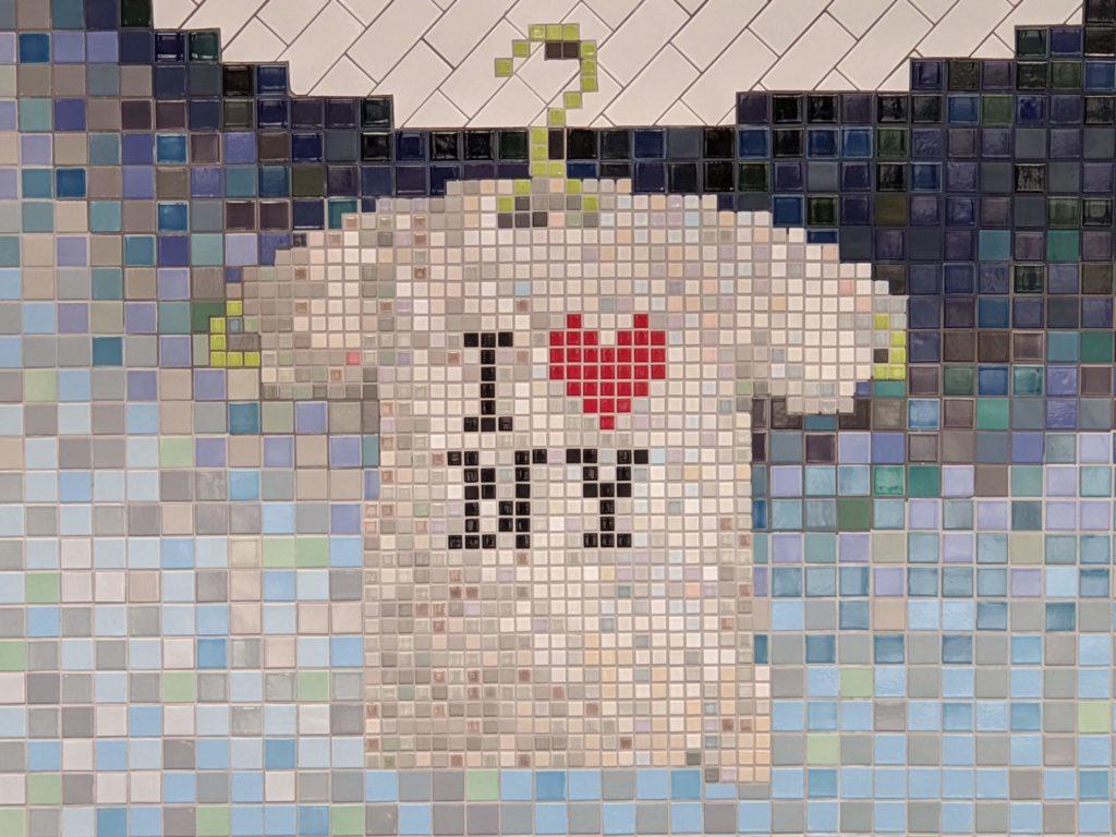 Part of a mosaic at LaGuardia Airport Terminal B showing I Love NY t-shirt