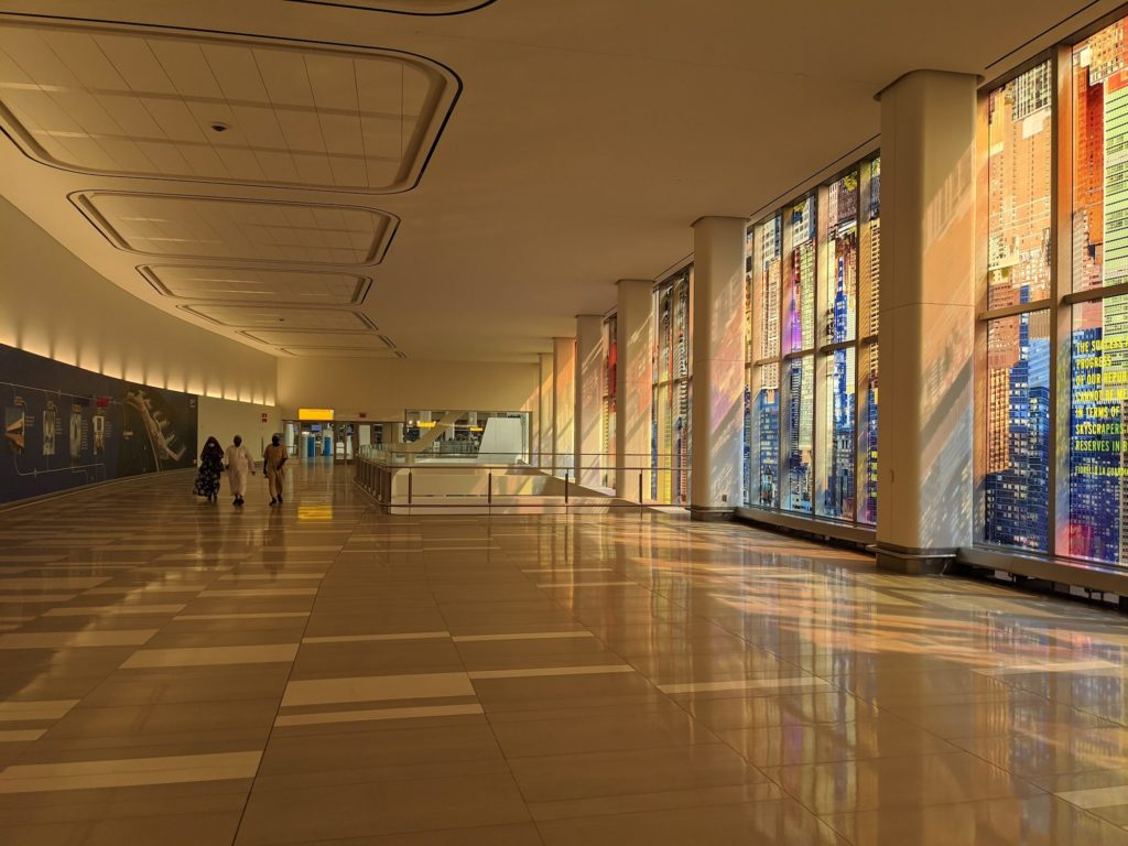 """Sabine Hornig's """"LaGuardia Vistas"""" illuminates the connecting hall from parking to Terminal B at LaGuardia."""