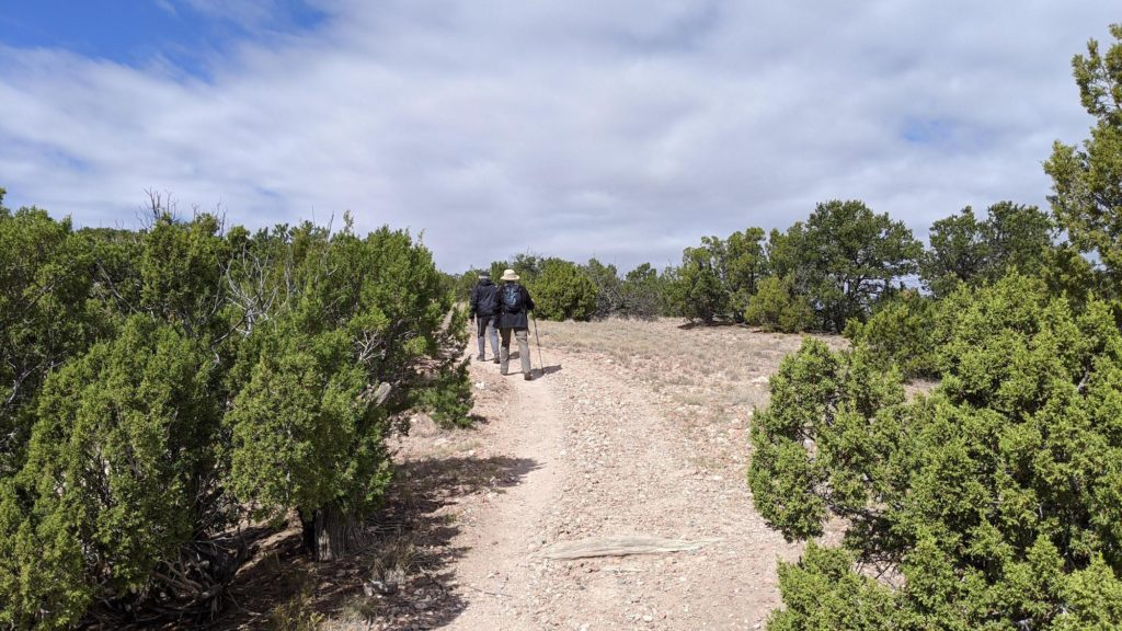 2 people hiking in Galisteo Basin, Santa Fe.