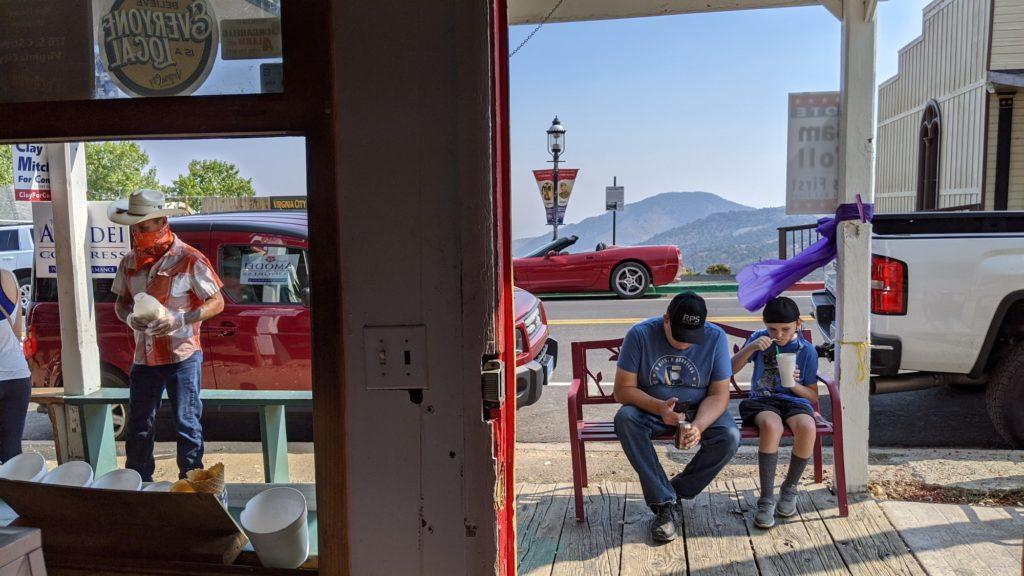 Street scene in Virginia City outside ice cream parlor.