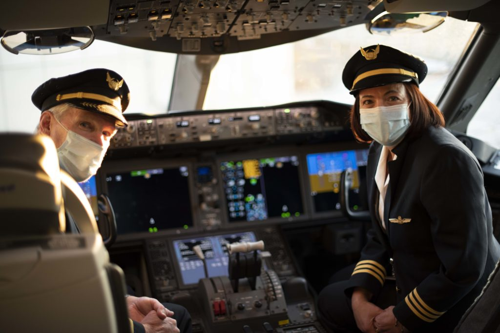 Airline Pilots wear face masks in cockpit.