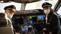 Airline pilots wear face masks in the cockpit of a United flight.