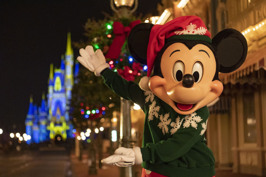Mickey Mouse welcomes guests to Magic Kingdom.