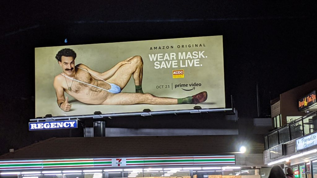 Sacha Baron Cohen promotes the use of face masks on Sunset Blvd. billboard