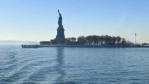 Statue of Liberty seen in the distance from the water.