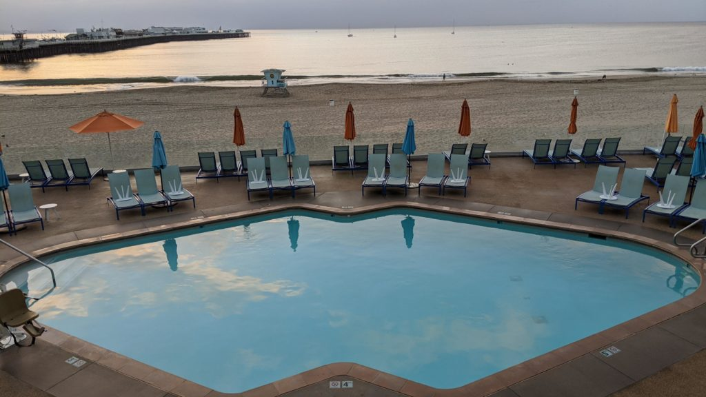 View of the pool and Pacific Ocean from room at The Dream Inn.