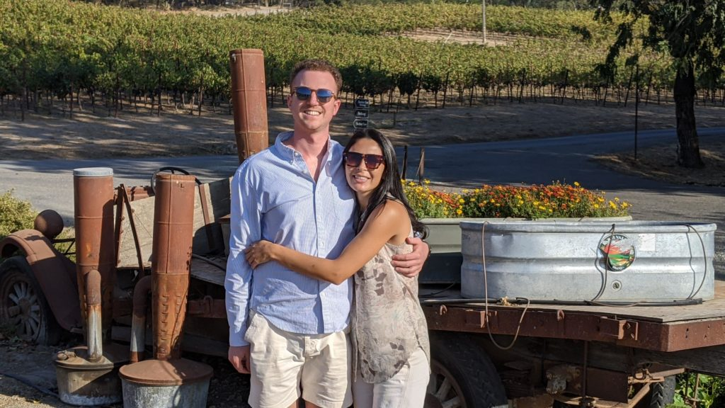 Couple in front of flower display at Gundlach Bundschu Winery.