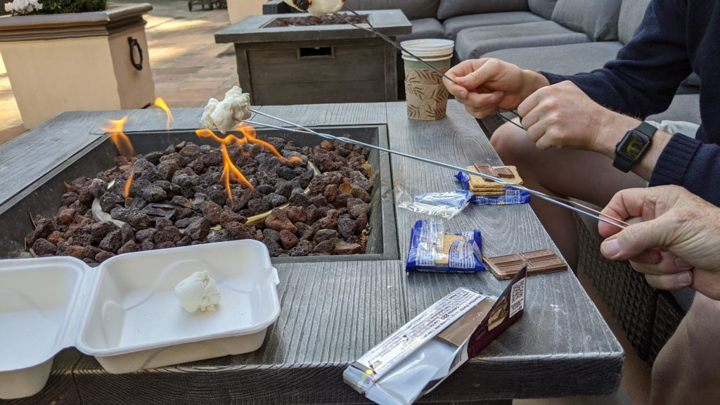 Roasting s'mores over a fire it at Fairmont Sonoma Mission Inn.
