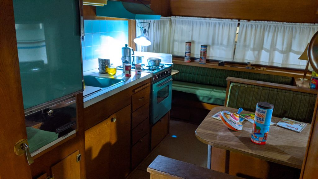 A light blue interior of a 1966 Kenskill travel trailer at Sisemore RV Museum.