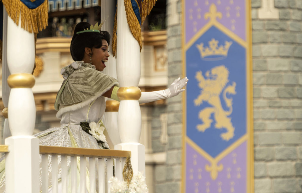 Princess Tiana waves to guests at Walt Disney World Resort. photo by Kent Phillips for WDW.