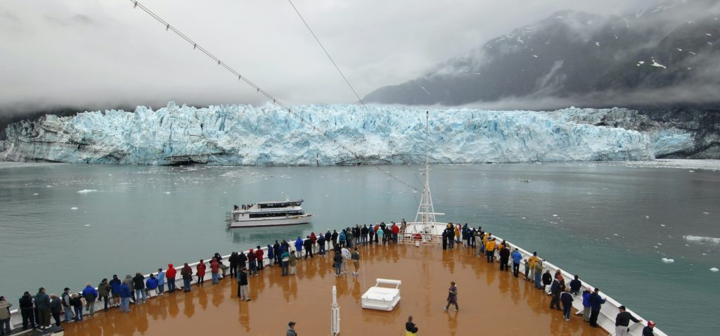 Passengers aboard Holland America Line's ms Zaandam line the forward deck as they view Margerie Glacier