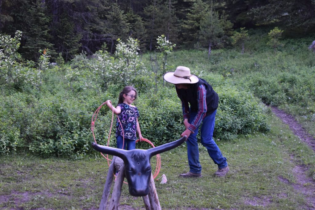 Girl roping a steer's head at Hawley Mountain Guest Ranch in McLeod, Montana.
