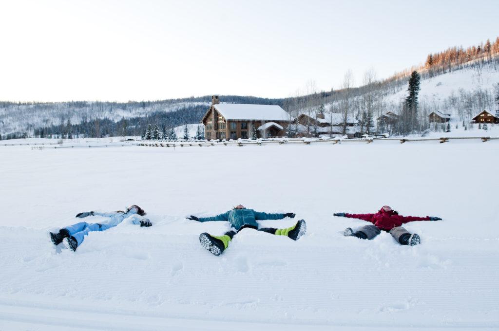 Three snow angels at Vista Verde Ranch in Clark, Colorado