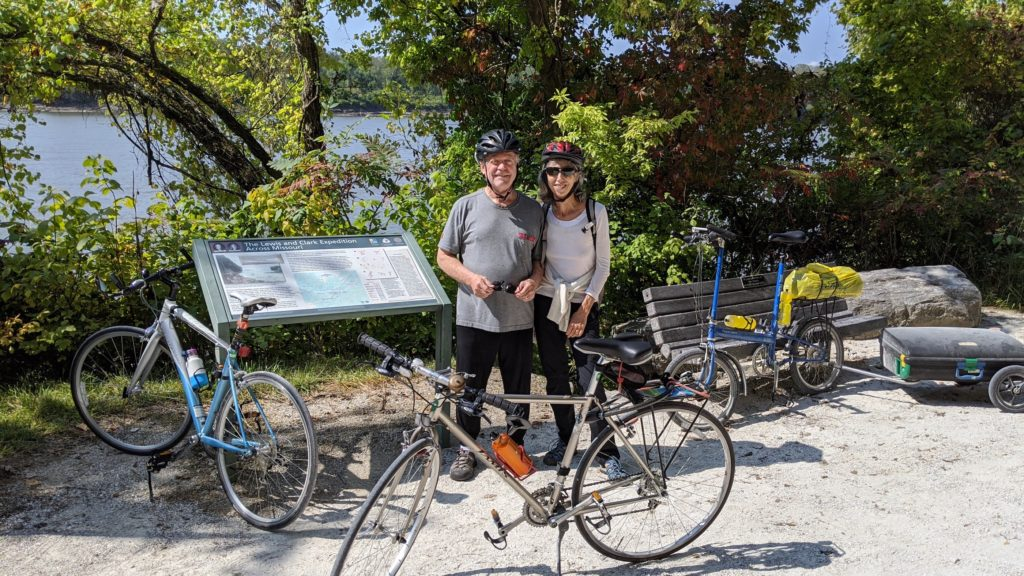Two bike riders pause to read about the Lewis & Clark encampment along the Katy Trail on the Missouri River.