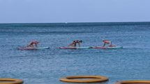 Aquarobics class on standup paddleboards off the coast of Palm Beach, Aruba.