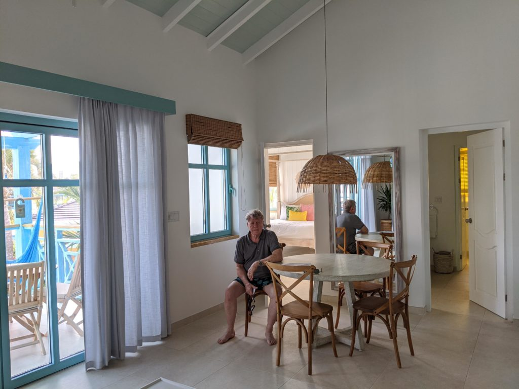 Man in a one-bedroom suite at the Boardwalk Boutique Hotel Aruba.
