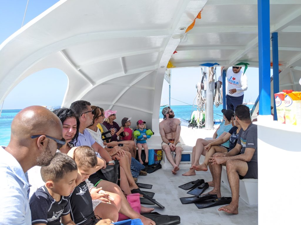 Fsamilies aboard the Dolphin Catamaran on a Delphi Tours afternoon snorkel trip.
