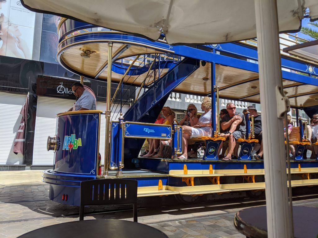 Trolley runs through back lanes of Oranjestad in Aruba.