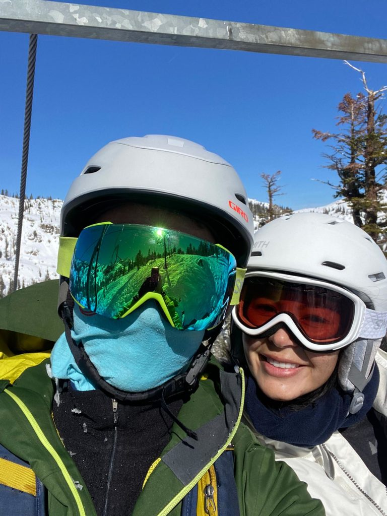 Couple in goggles on chairlift at Squaw Valley in Lake Tahoe.
